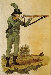 Green jacketed rifleman firing Baker rifle 1803