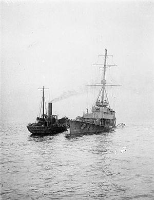 HMS Arethusa (1913) - A tug alongside the wreck of Arethusa after Arethusa was badly damaged by a mine off Felixstowe, 11 February 1916