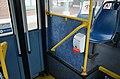 Hand-sanitizer dispenser at rear door of a TriMet bus in June 2020.jpg