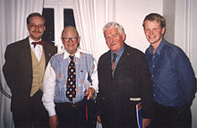 Povel Ramel (second from left) and Hans Alfredson (second from right) being hosted by a student association at Lund University in 1999