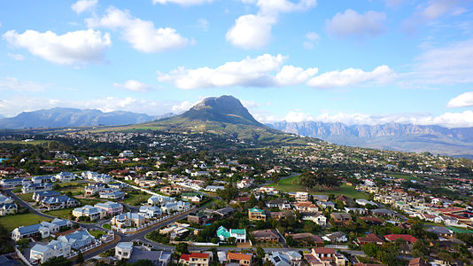"Heldervue (meaning ""clear view"") is suburb in Somerset West which is a town in the Western Cape, South Africa. It is situated in the Helderberg area (formerly called Hottentots Holland), about 50 kilometres east of Cape Town central city area, and 10 kilometres from Strand. The town is overlooked by the Helderberg (meaning ""clear mountain"")."
