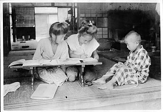 Homework - Japanese students doing homework, c. 1915