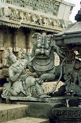 Hoysala Empire - Sala fighting the Tiger, the emblem of the Hoysala Empire at Belur, Karnataka.