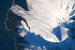 Satellite image of the southern tip of Heard Island. Cape Arkona is seen on the left side of the image, with Lied Glacier just above and Gotley Glacier just below. Big Ben Volcano and Mawson Peak are seen at the lower right side of the image.