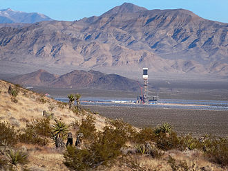 Solar power in the United States - Looking north towards the Ivanpah Solar Power Facility's eastern boiler tower from Interstate 15 in California.