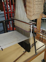 Close-up view of comber board, harness, mails, weights (Lingoes) and warp with 1040 ends