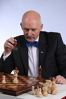 Janusz Korwin-Mikke playing chess.jpg