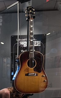 "John Lennon's missing 1962 Gibson J-160E (clip) - ""Ladies and Gentlemen... the Beatles!"" exhibit at LBJ Presidential Library, Austin, TX, 2015-06-10.jpg"