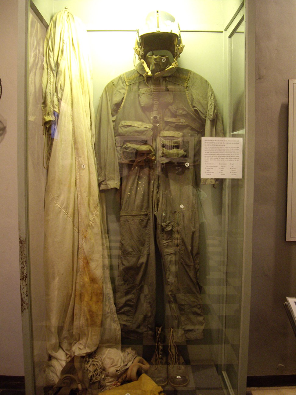 flight suit hanging in a display case