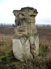 Sokl krucifixu s reliéfem Františka Xaverského