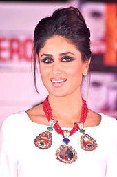Kareena Kapoor clad in a white dress and a red necklace