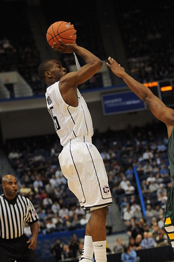 English: Kemba Walker takes shot against UVM o...