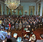 President Lyndon B. Johnson speaks to a television camera at the signing of the Civil Rights Act of 1964
