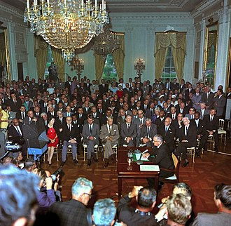 Civil Rights Act of 1964 - President Johnson speaks to a television camera at the signing of the Civil Rights Act.