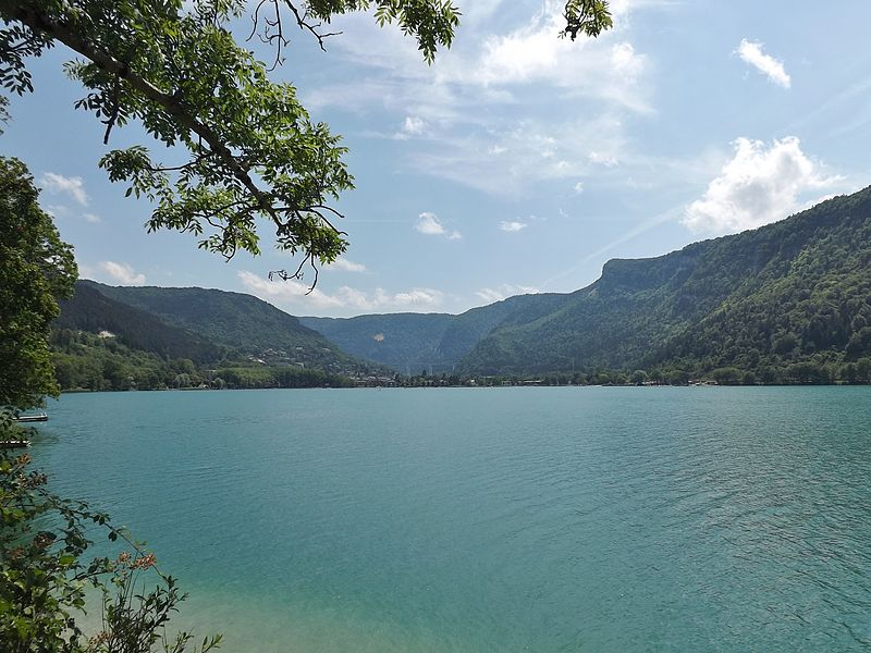 Sight of the lac de Nantua lake, with at the background city of Nantua and viaduc of Nantua, in the Jura mountains, department of Ain, France.
