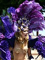 Lady in blue and purple feathers (2557875388).jpg