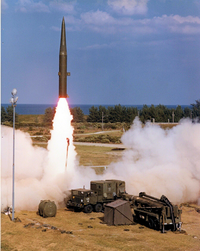 missile launching, missile in foreground prepared for launch