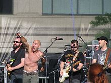 Live onstage with Ed Kowalczyk pointing his microphone to the crowd