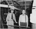 Lt. Commander N. V. King, Engineering Officer, conducts President Harry S. Truman through the engine room on a tour... - NARA - 198733.tif