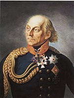 Painting shows a partially bald man with light-colored hair. He wears a dark blue military uniform with two rows of buttons, a large loop of gold braid over his shoulder and a large Iron Cross just below his chin.