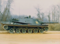 MBT70 on the move flank.png