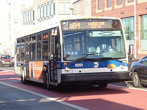 Bus lanes in New York City - A Q84 bus using an offset bus lane in Jamaica, Queens