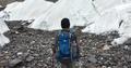 Man trekking on Baltoro Glacier.png