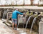Man washing his leg at Dhunge Dhara, Matatirtha -9018.jpg