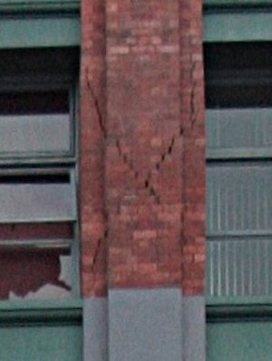 Manchester Courts - Detail showing damage to one masonry column