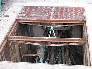 Manhole - PMG manholes in a city street, Perth, Western Australia.