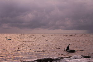 Marari Beach - Fisherman setting off into the sunset