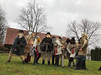 "Mārtiņi - A Mārtiņi mumming group consisting of participants from folklore group ""Rudzupuķe"" and Latvian world-view society ""Saulesrits"", November 25, 2017"