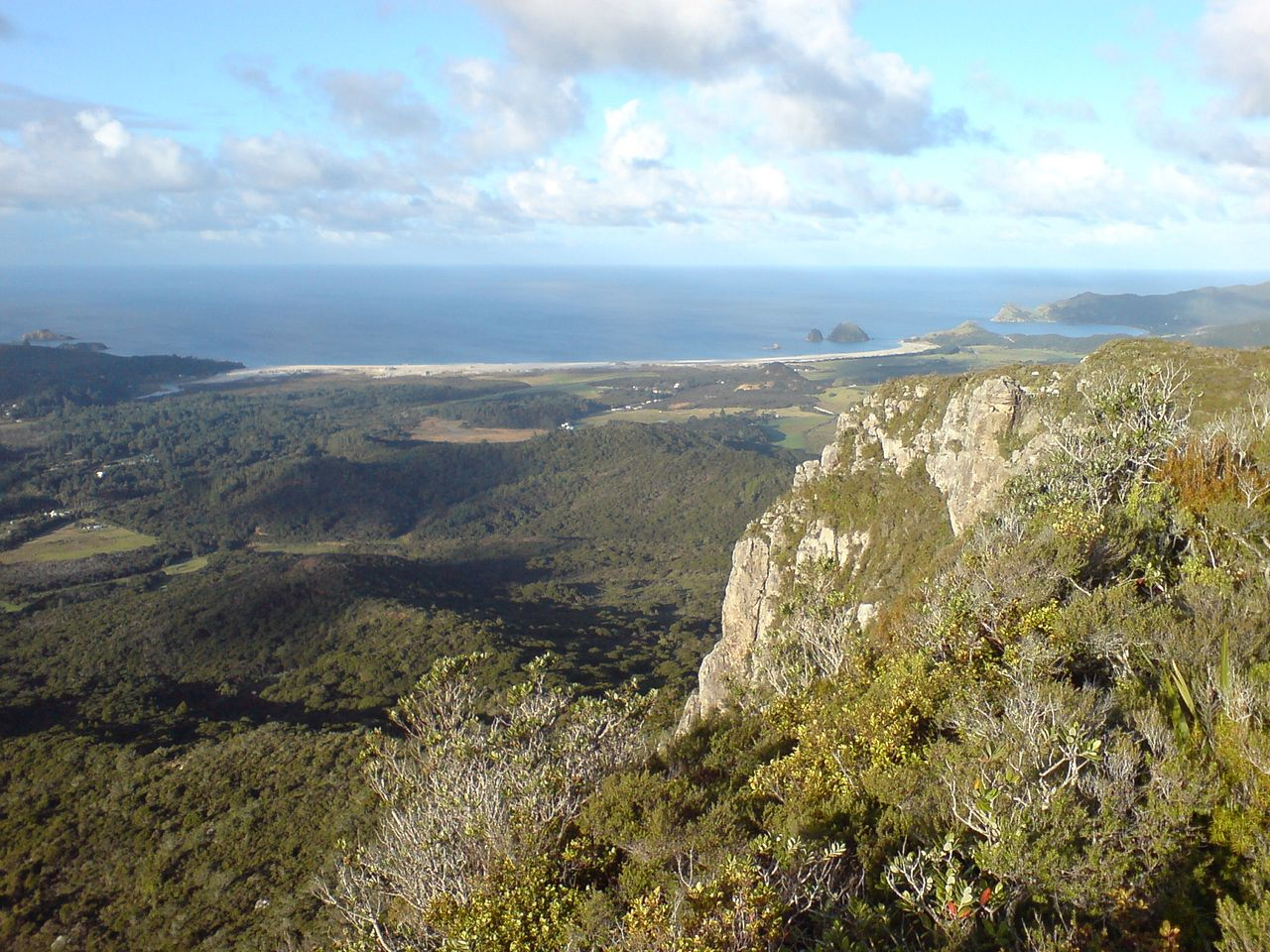A view over the eastern coast of Great Barrier Island, from a ridge line in the center of the island