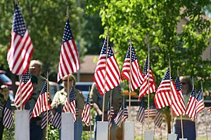 Flagged crosses for Memorial Day civic ceremon...