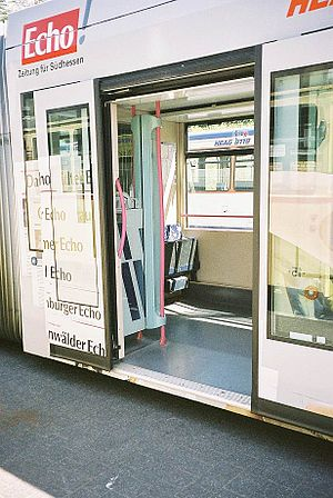 "Low-floor tram - Entry door of a low-floor tram, with ""roll-in"" level floor accessibility."