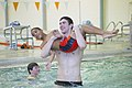 Michael Phelps with an im program participant - 20100308.jpg