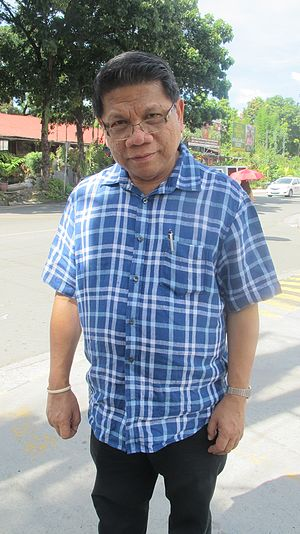 Mike Enriquez - Mike Enriquez in 2016, outside White Plains Subdivision in Quezon City