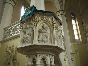 Protestantism - Key figures of the Protestant Reformation: Martin Luther and John Calvin depicted on a church pulpit. These reformers emphasised preaching and made it a centerpiece of worship.