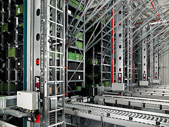 Automated storage and retrieval system - Automated 4 aisle miniload warehouse with single mast stacker cranes.