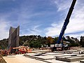 Mobile crane lifting precast concrete walls for the constrution of a three-storey international style hotel (1).jpg