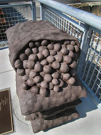 Millers River (Middlesex) - Four 50 lb burlap sacks of potatoes, made of cast stone, recall the massive potato sheds along Millers River that burned in 1962.