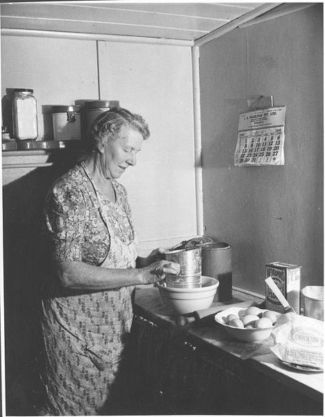 File:Mrs Robert Wharton making a cake in her kitchen, Drouin, Victoria, 1945. (6173546647).jpg