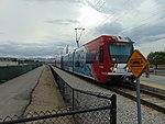 NB Red Line TRAX train at Jordan Valley station, Apr 16.jpg