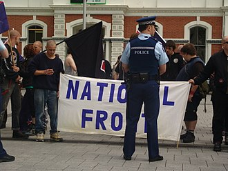 New Zealand National Front - NZ National Front members at a protest in 2007, with a policeman watching nearby.