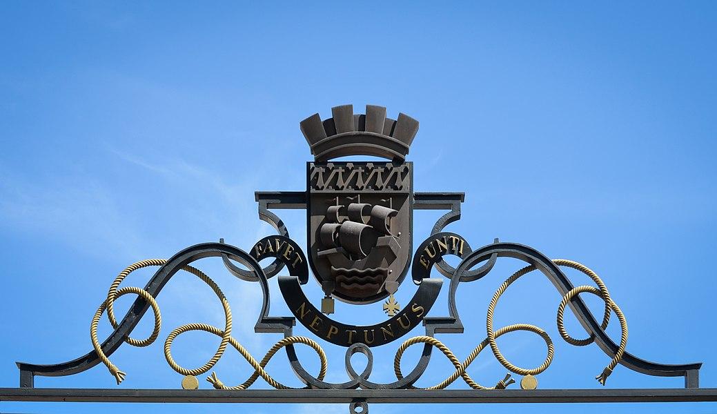 Wrought iron escutcheon of Nantes city hall with latin motto Favet Neptunus Eunti - France