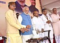 "Narendra Modi being presented a memento by the Chief Minister of Madhya Pradesh, Shri Shivraj Singh Chouhan, at the launching ceremony of the ""Gram Uday se Bharat Uday"" Abhiyan, in Mhow, Madhya Pradesh (1).jpg"