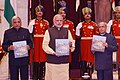 Narendra Modi releasing two books – 'Speeches of the President – Vol.III' and 'Presidential Retreats', at Rashtrapati Bhavan, in New Delhi on December 11, 2015. The President, Shri Pranab Mukherjee is also seen.jpg