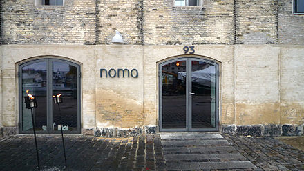 Noma is an example of Copenhagen's renowned experimental restaurants, and has gained two Michelin stars. Noma entrance.jpg