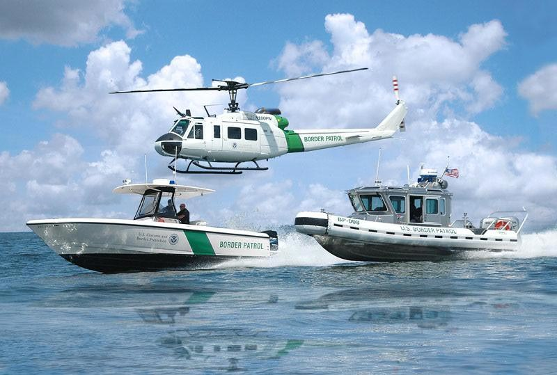 Office of CBP Air and Marine helicopter and boats