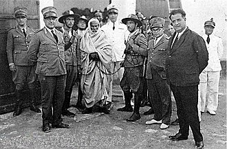 Pacification of Libya - Senussi rebel leader Omar Mukhtar (the man in traditional clothing with a chain on his left arm) after his arrest by Italian armed forces in 1931. Mukhtar was executed in a public hanging shortly afterward.